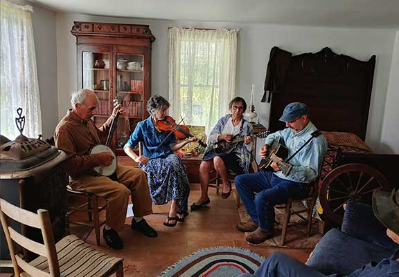 View of a music jam in the Matthews Living History Farm Museum